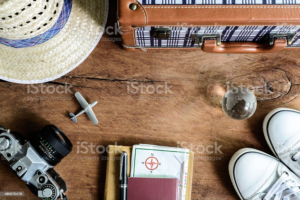 Outfit of traveler on wooden background stock photo
