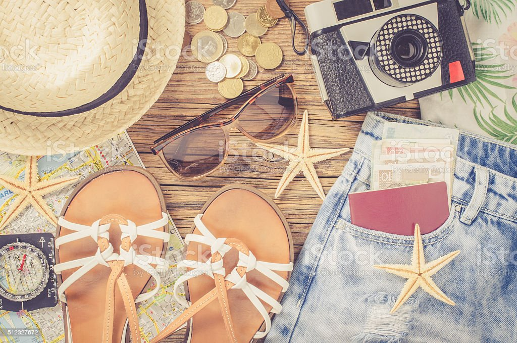 Outfit of traveler on wooden table stock photo