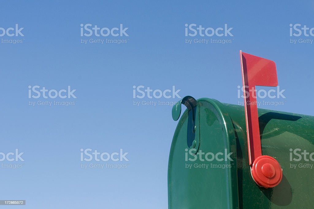 Outgoing mail in rural mailbox with flag in upright position stock photo