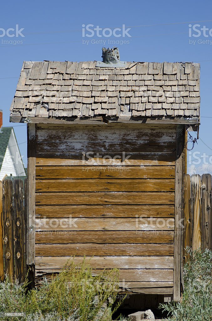 Outhouse with Shingled Roof stock photo