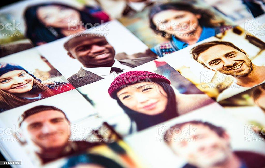 Outlay of multiracial faces printed stock photo