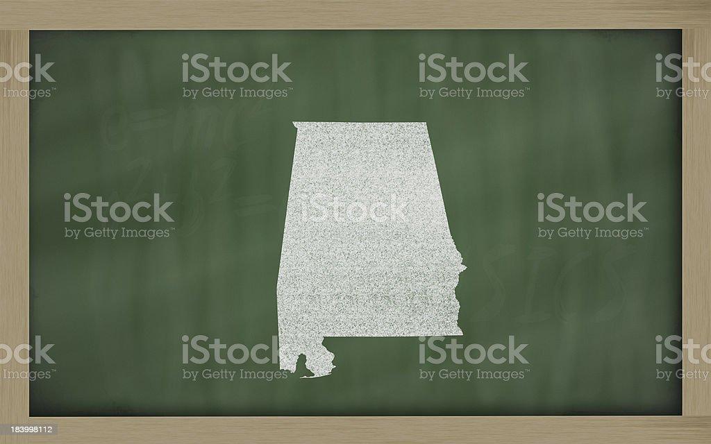 outline map of alabama on blackboard stock photo