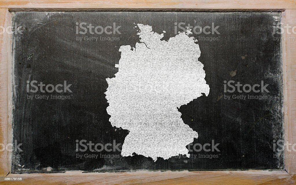 outline map of germany on blackboard stock photo