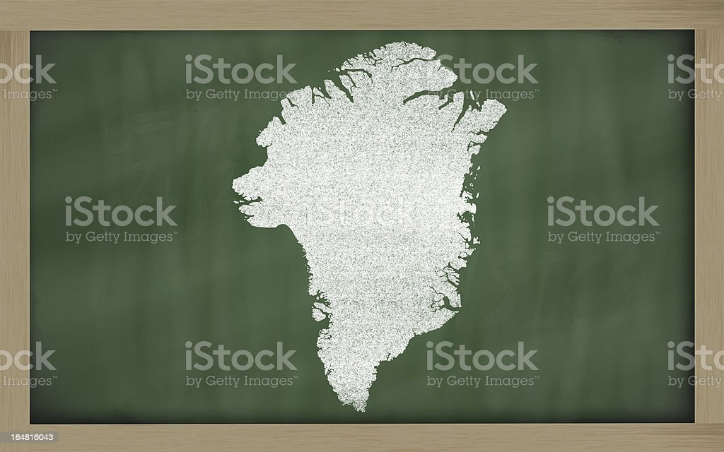 outline map of greenland on blackboard stock photo