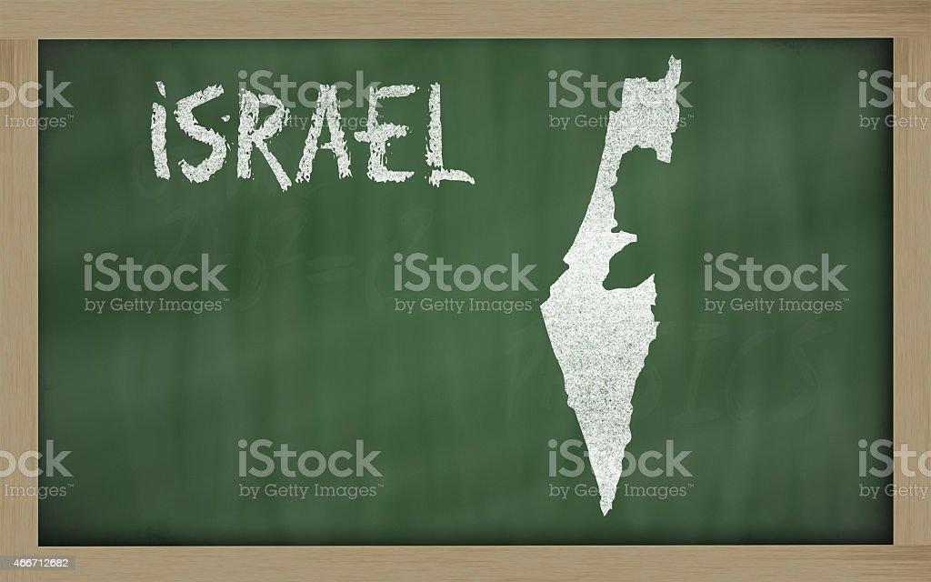 outline map of israel on blackboard stock photo