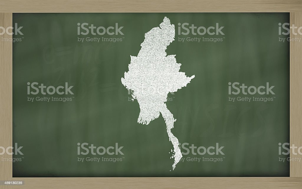 outline map of myanmar on blackboard stock photo