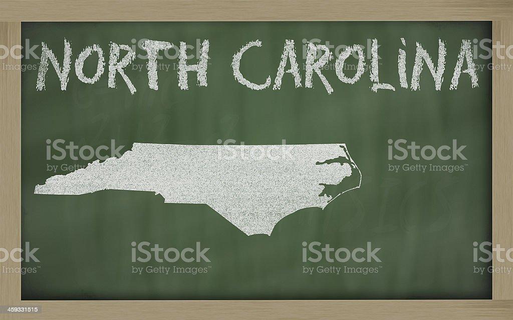 outline map of north carolina on blackboard stock photo