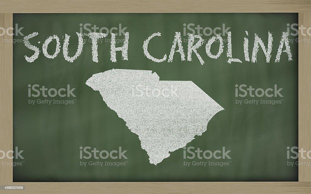 outline map of south carolina on blackboard stock photo