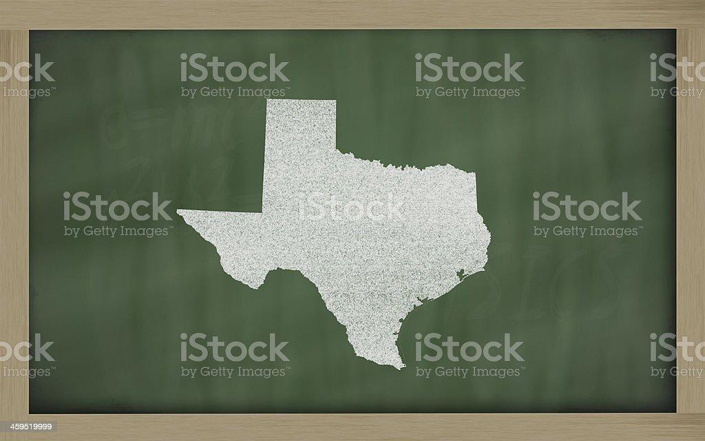 outline map of texas on blackboard stock photo