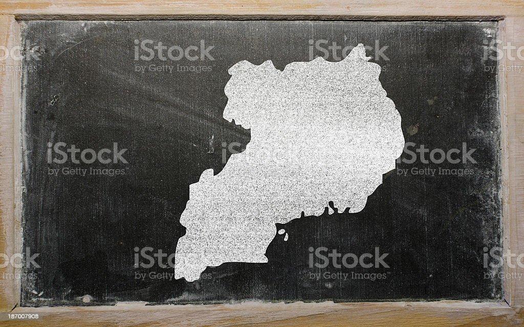 outline map of uganda on blackboard royalty-free stock photo