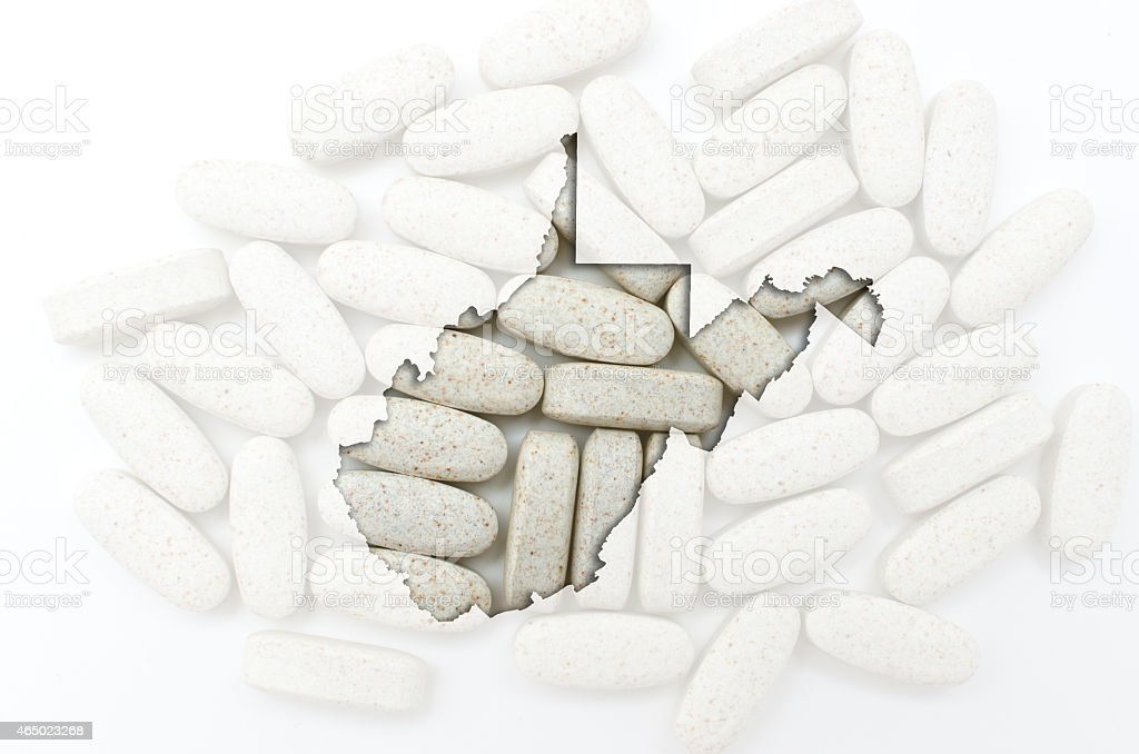 Outline map of west virginia with pills stock photo