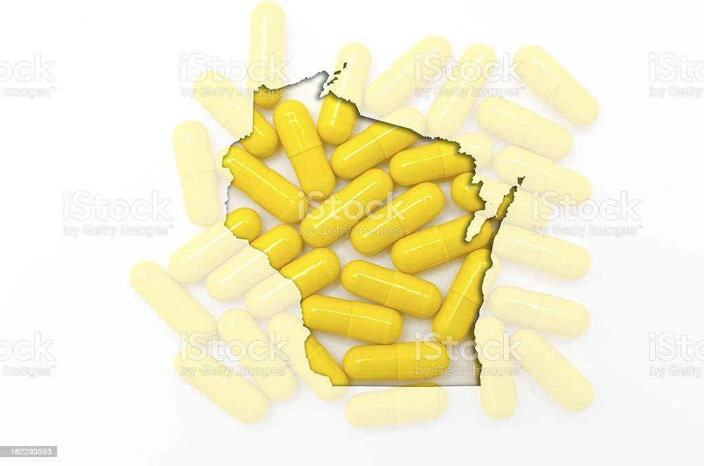 Outline map of wisconsin with transparent pills in the background royalty-free stock photo