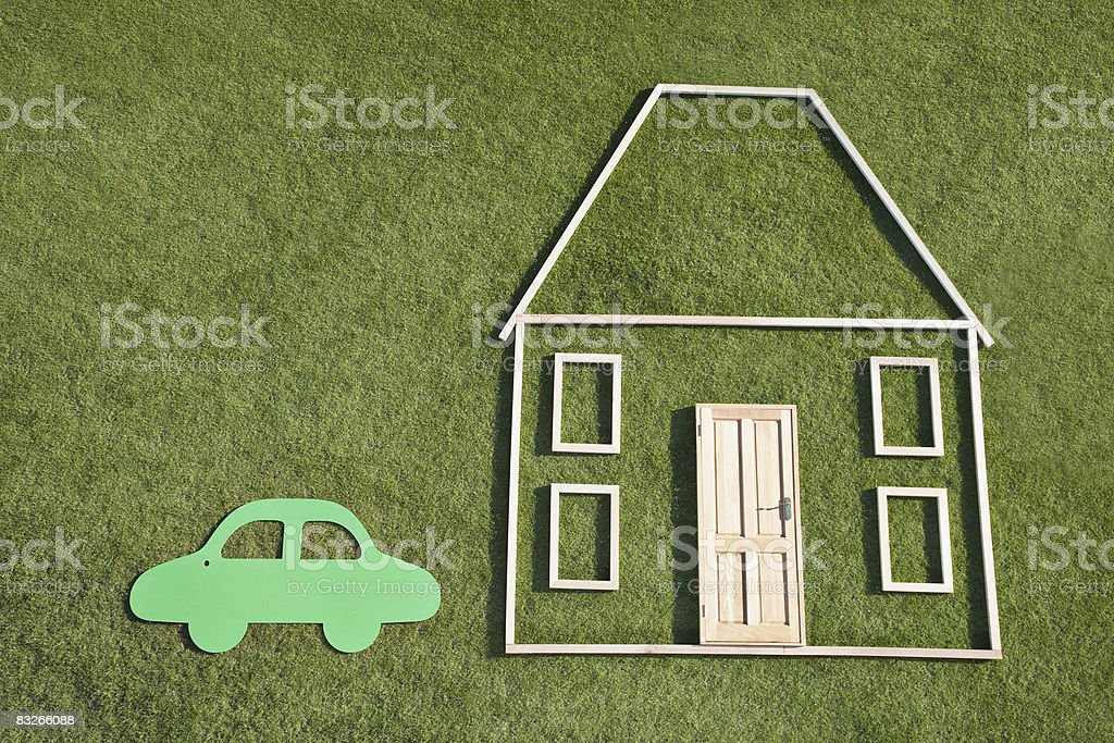 Outline of house and car in grass stock photo