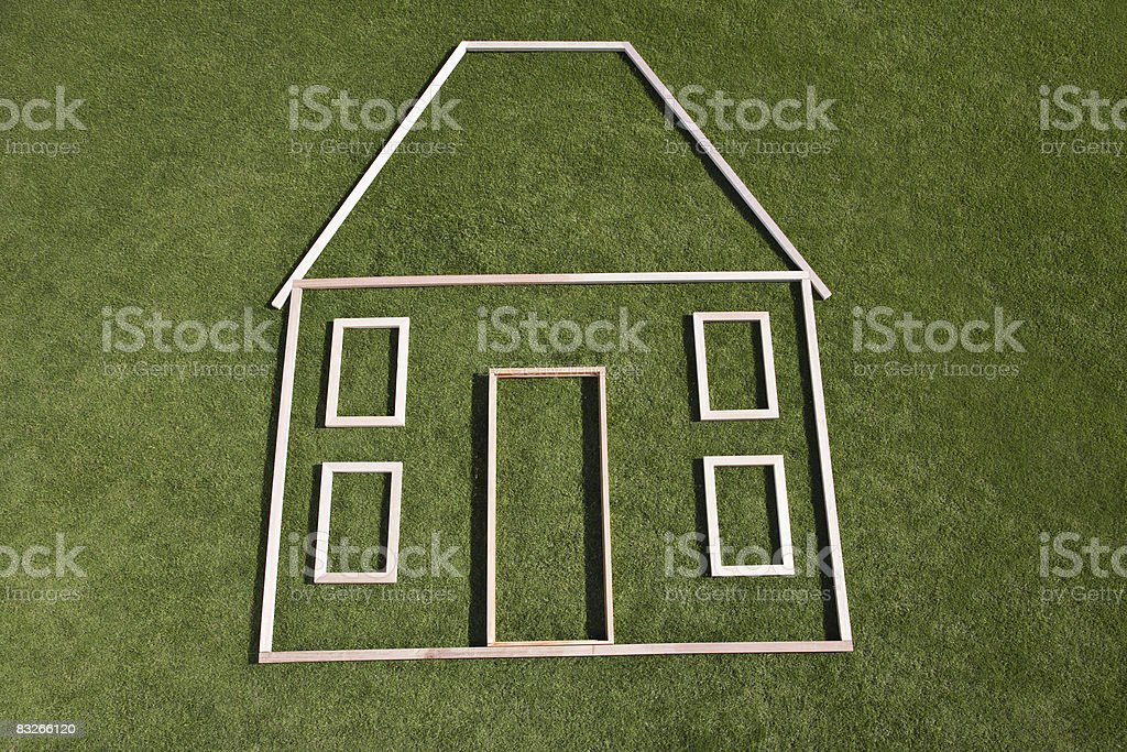Outline of house in grass stock photo