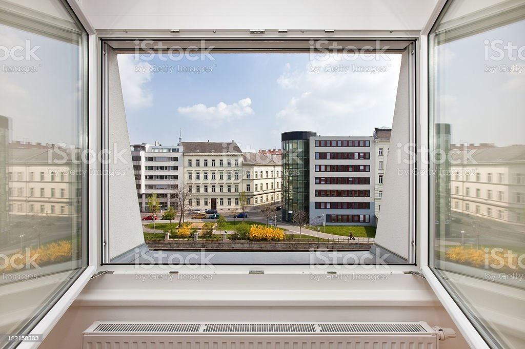 outlook from an apartment window on urban setting royalty-free stock photo