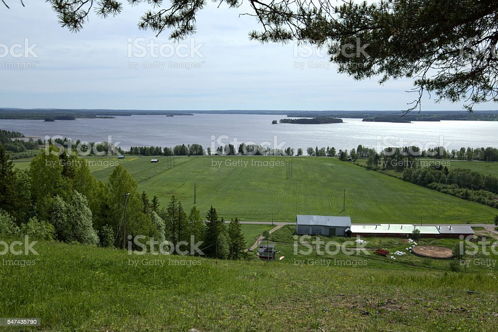Outlook over agricultural landscape and lake at Stroemsund, Sweden stock photo