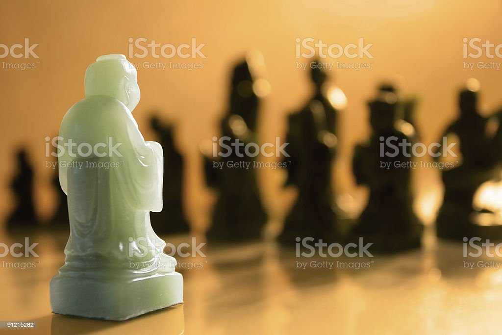 Outnumbered Chess Pawn stock photo