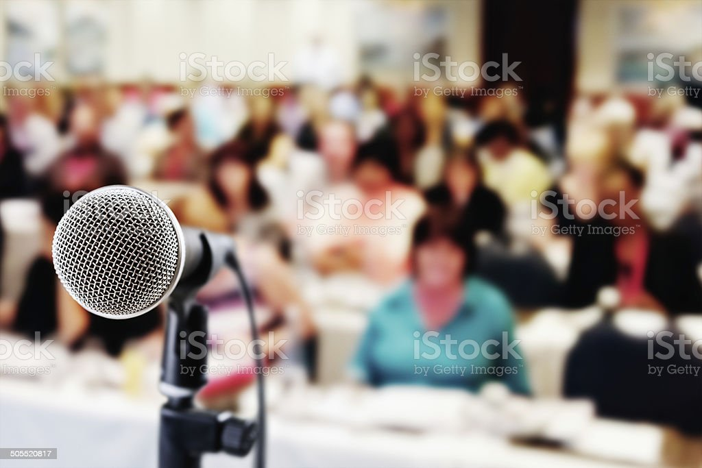 Out-of-focus audience waiting for speaker at seminar stock photo