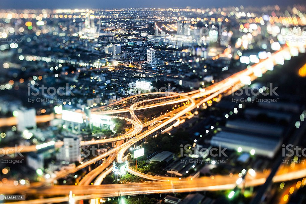 Out-of-focus distant shot of a highway and city at night stock photo