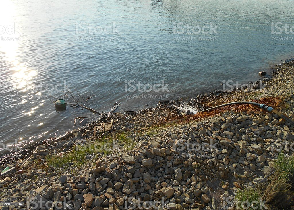 Outpouring waste water into the river stock photo