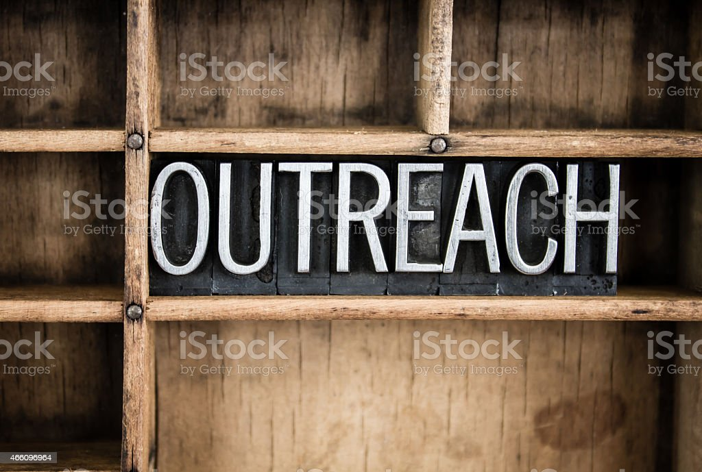 Outreach Concept Metal Letterpress Word in Drawer stock photo