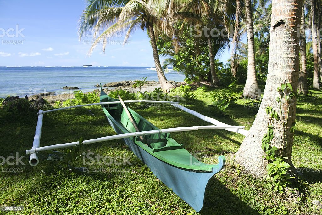 outrigger canoe tropical island beach philippines royalty-free stock photo