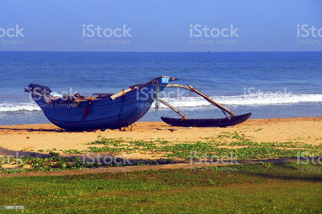 outrigger canoe used by fishermen - beach scene stock photo