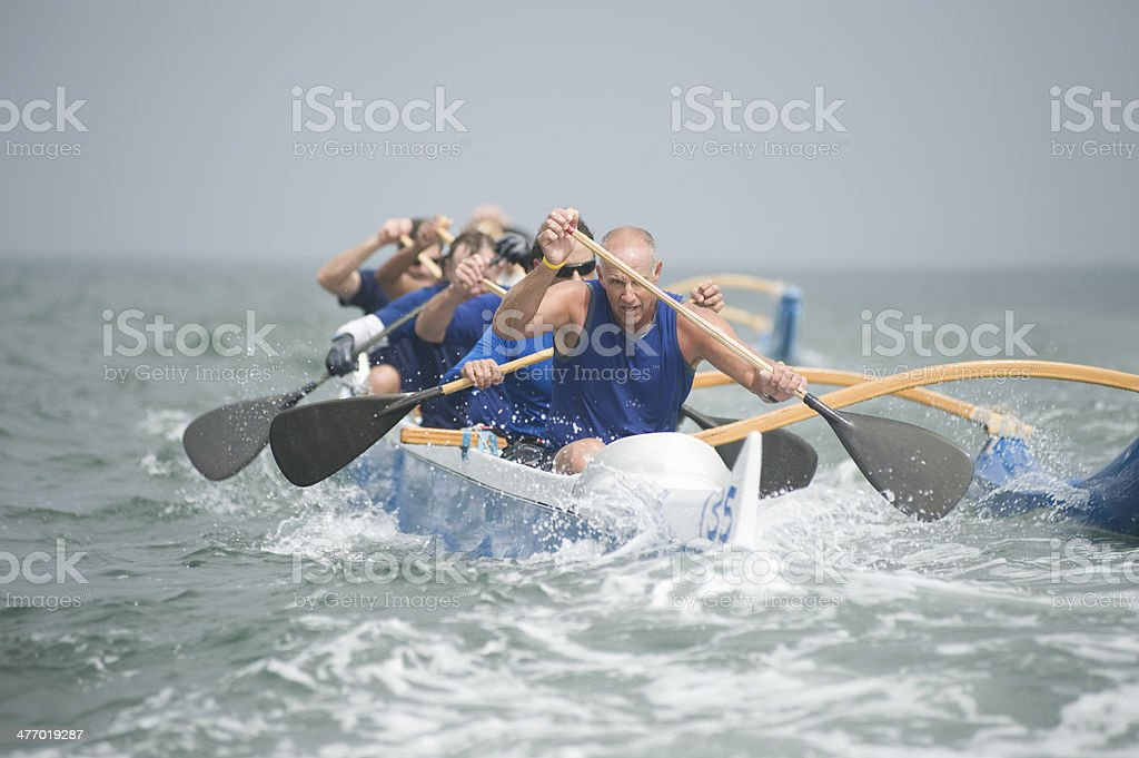 Outrigger Canoeing Team In Race stock photo