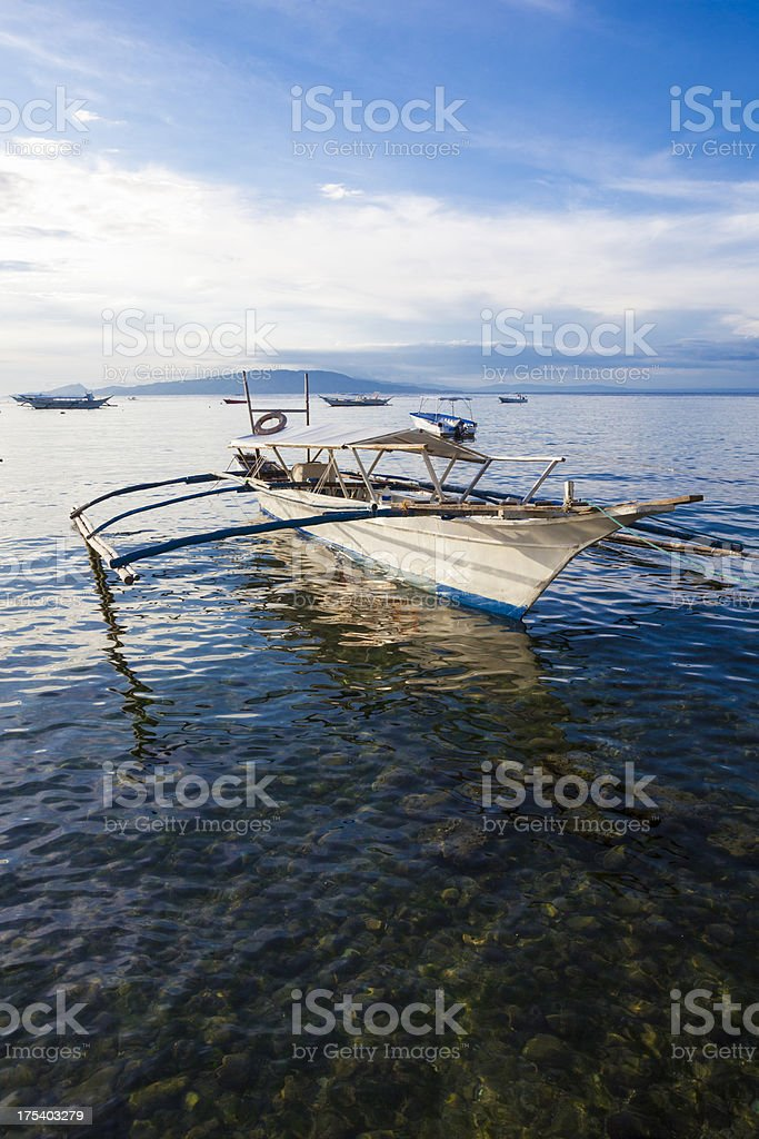 Outrigger style boat in Sabang, Philippines stock photo