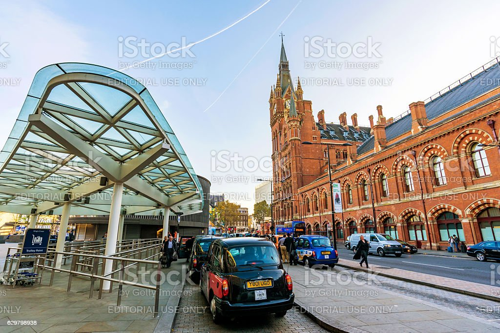 Outside area of Kings cross station with Taxis stock photo