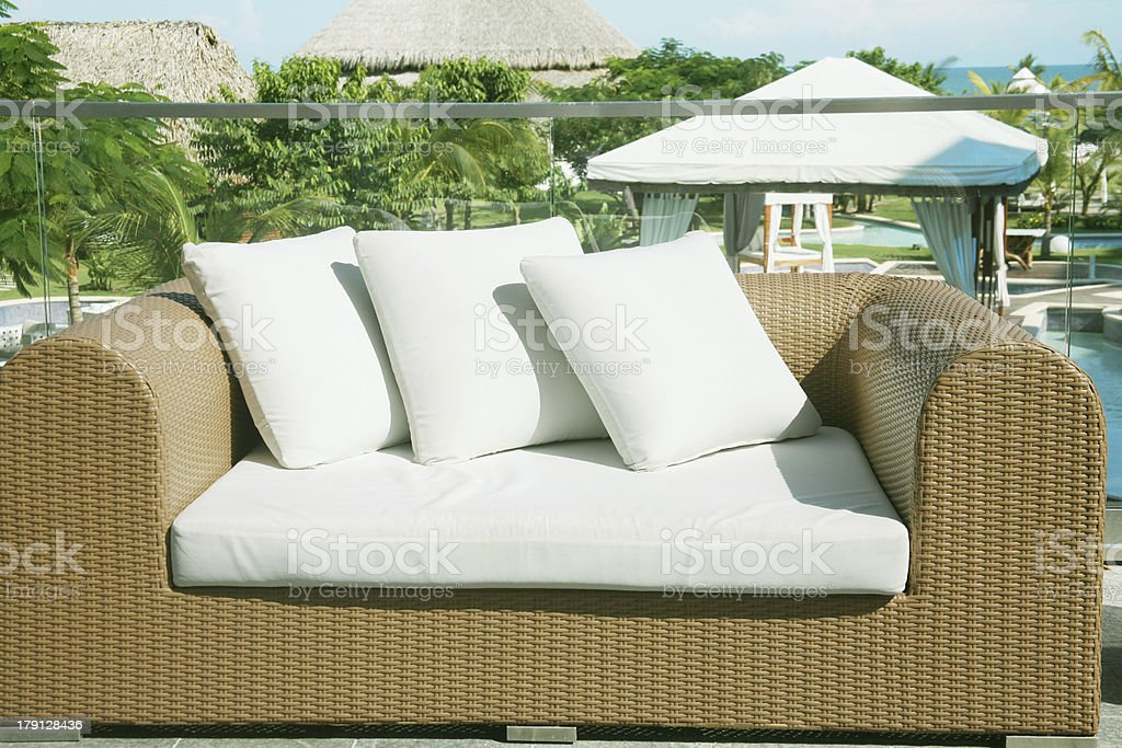 Outside lounge area nice framed with plants, flowers royalty-free stock photo