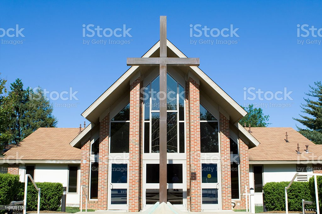 Outside of Modern Church with Large Cross in Front stock photo