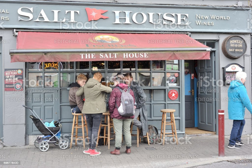 Outside of the bar Salt House bar where some fryends are having fun. stock photo