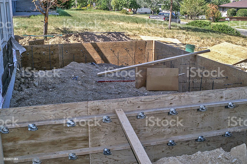 Outside Plywood Forms Built for Footings on Home Addition stock photo