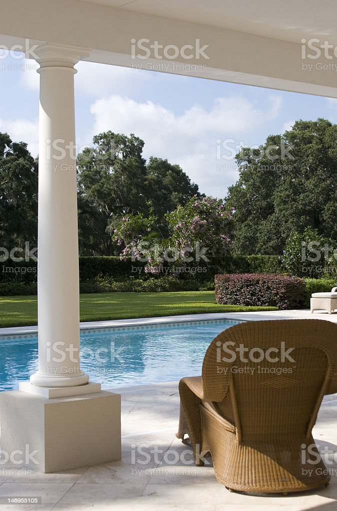 Outside Pool with Chair and Column royalty-free stock photo