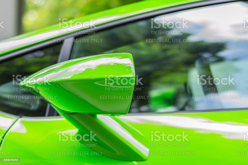 Outside rearview mirror of a green sports car stock photo