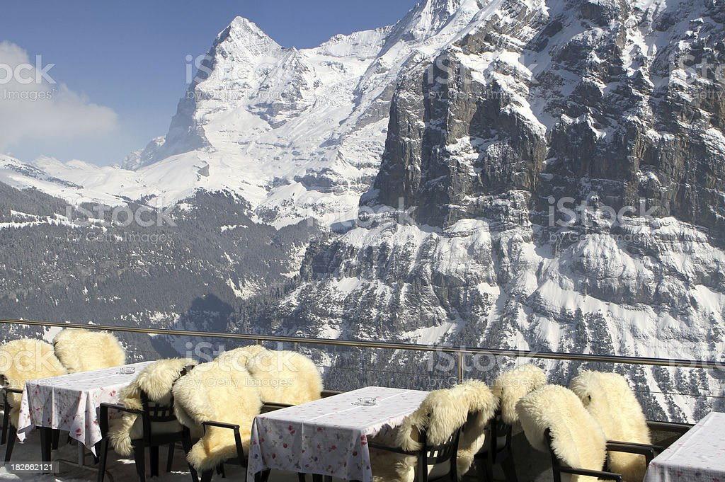 Outside restaurant tables in Murren with an Eiger view, Switzerland royalty-free stock photo