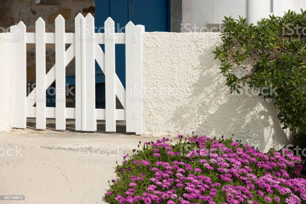 Outside typical Greek Island home front garden in spring stock photo