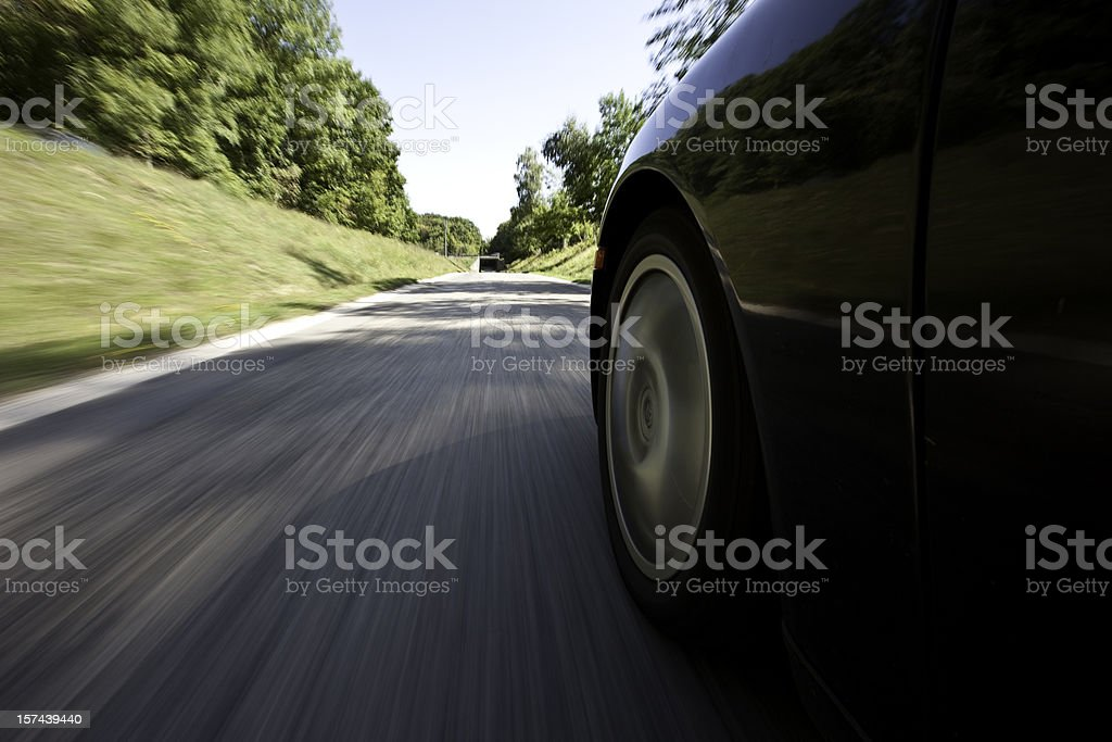 Outside view of a car driving down the street stock photo
