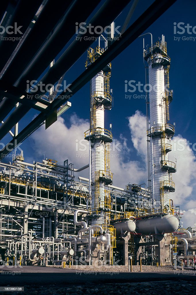 Outside view of a oil refinery on a blue sky day  stock photo