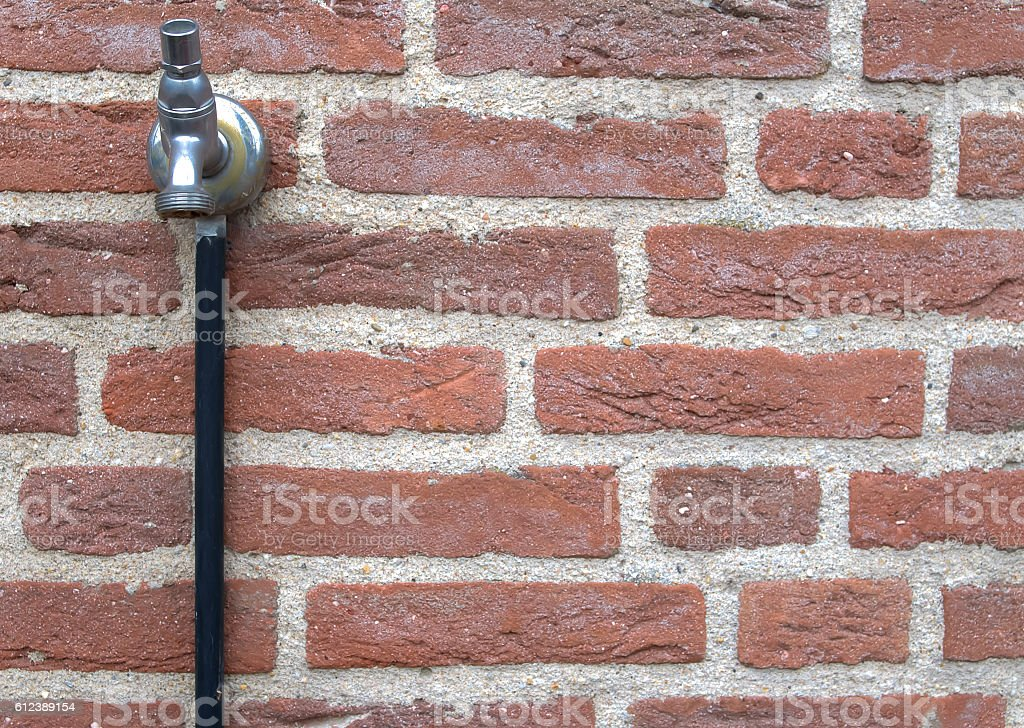 outside water tap stock photo