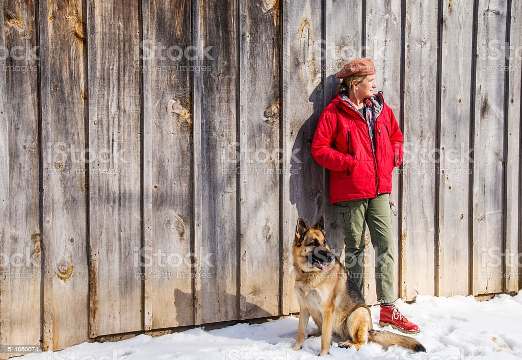 Outside with the dog on a sunny winter day stock photo