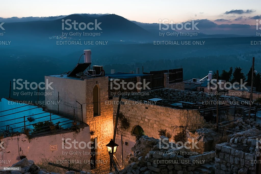 Outskirts  old town in  evening light and views of Moun stock photo