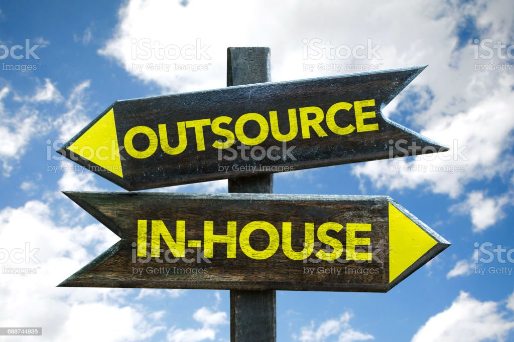 Outsource / In-House sign stock photo