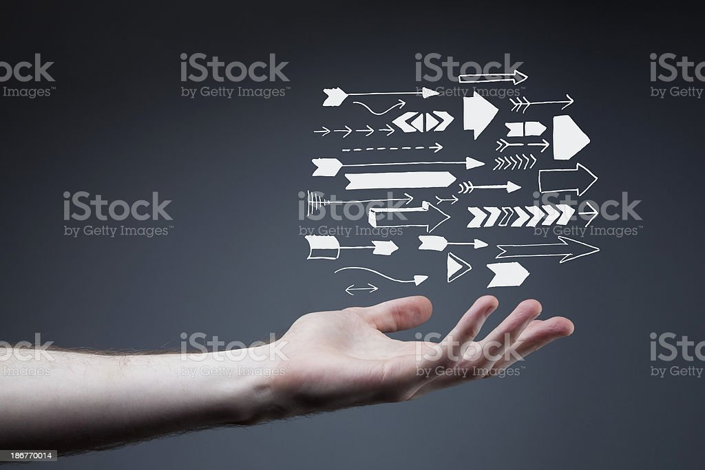 outstretched arm with arrows stock photo