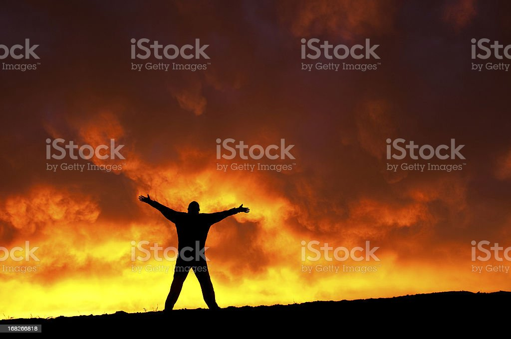 Outstretched Arms with Man in Praise and Worship royalty-free stock photo