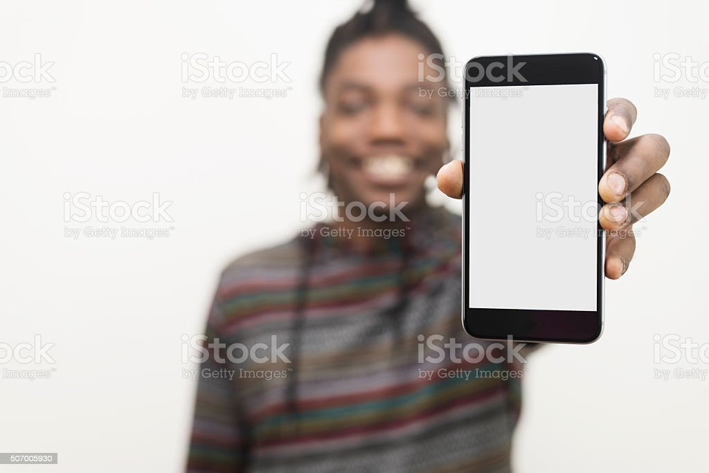 outstretched hand with blank smart phone and clipping path stock photo