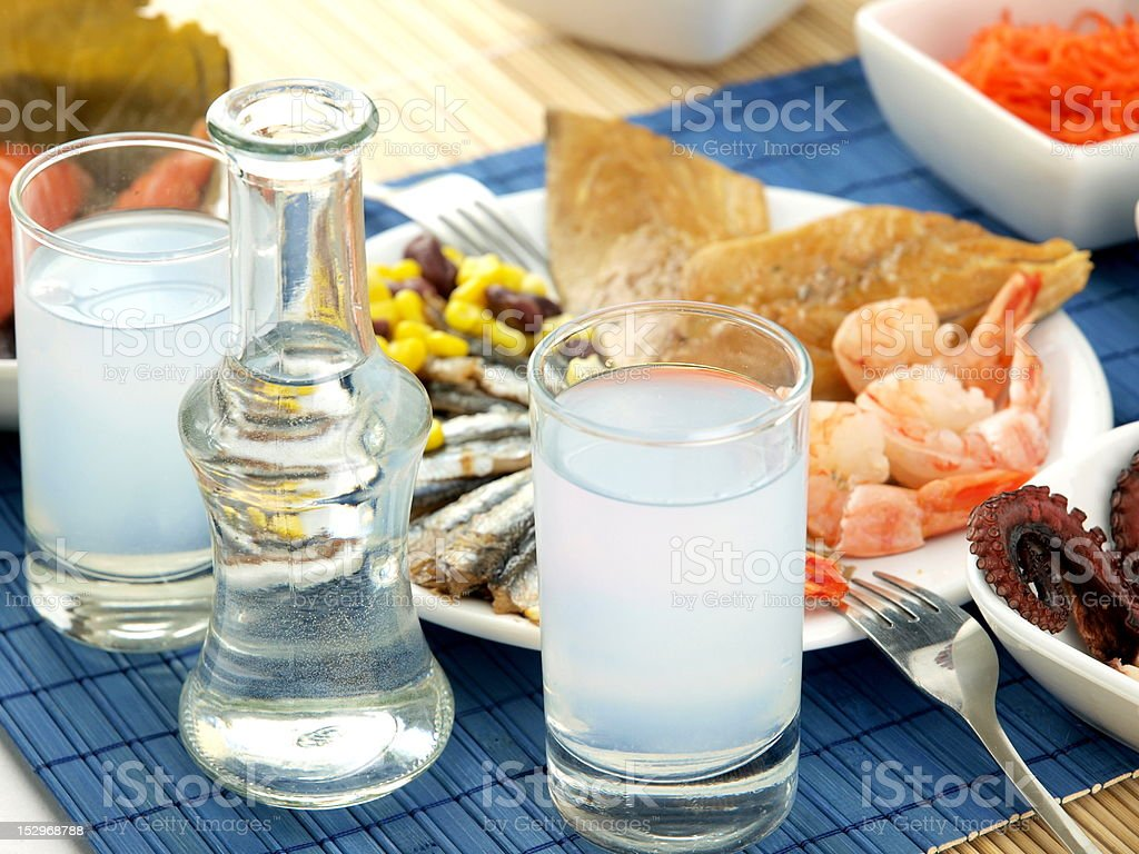 Ouzo and seafood on a table stock photo