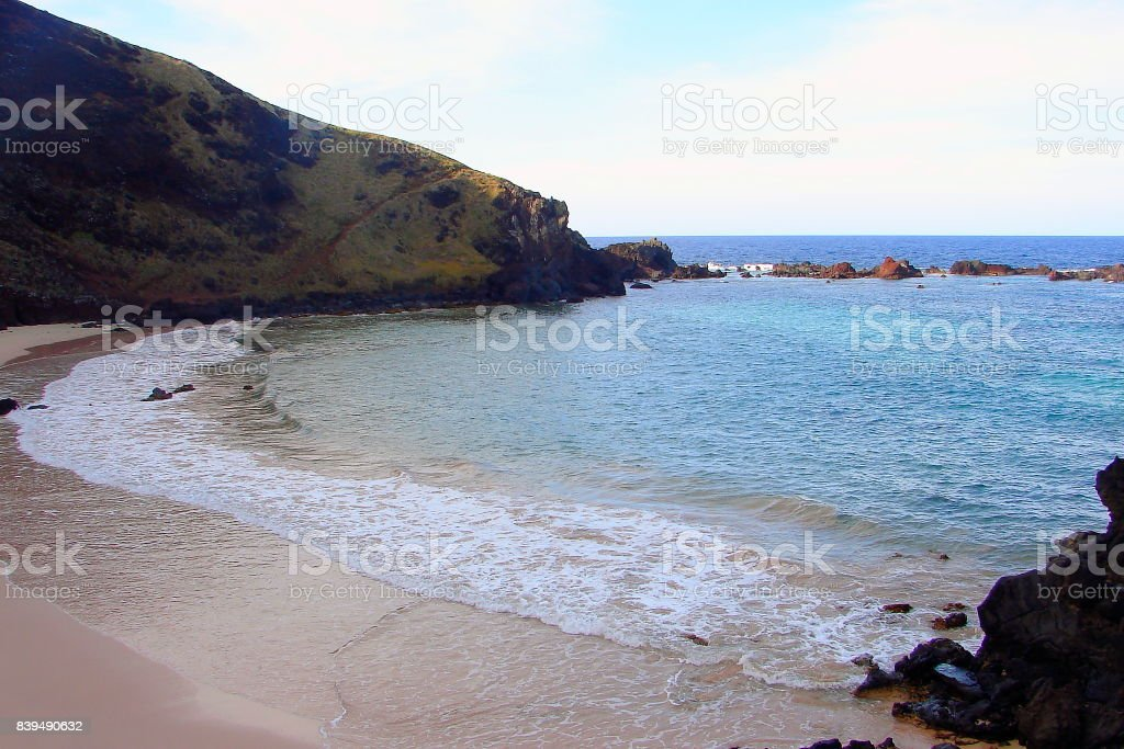 Ovahe beach at dawn - Impressive Easter Island and dramatic coastline shore: blue waves splashing on the rocks formation cliffs - Rapa Nui ancient civilization -  Idyllic pacific ocean at dramatic sunset, dramatic landscape panorama – Chile stock photo