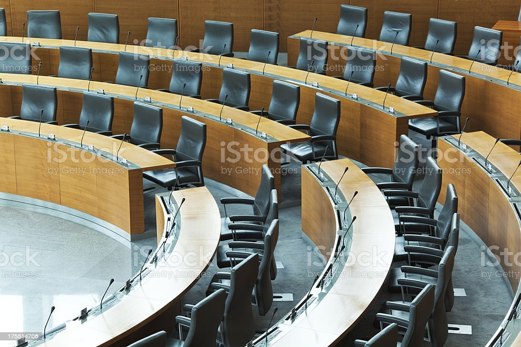 Oval conference room with rows of seats stock photo